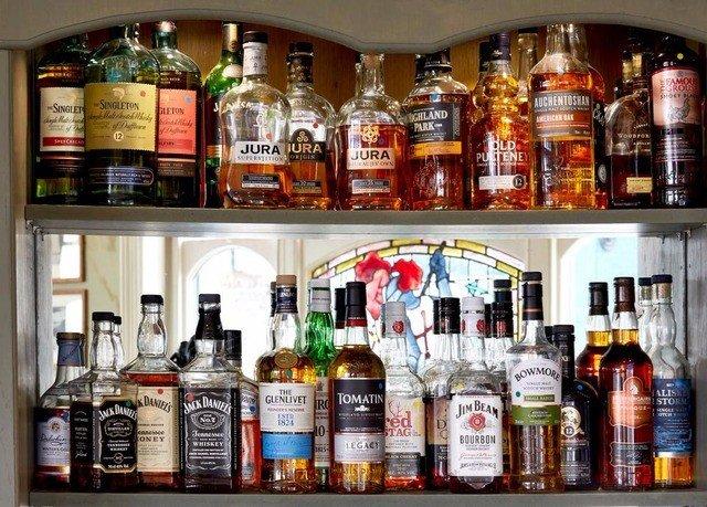bottle liquor store distilled beverage alcohol Drink whisky Bar brand lots cluttered