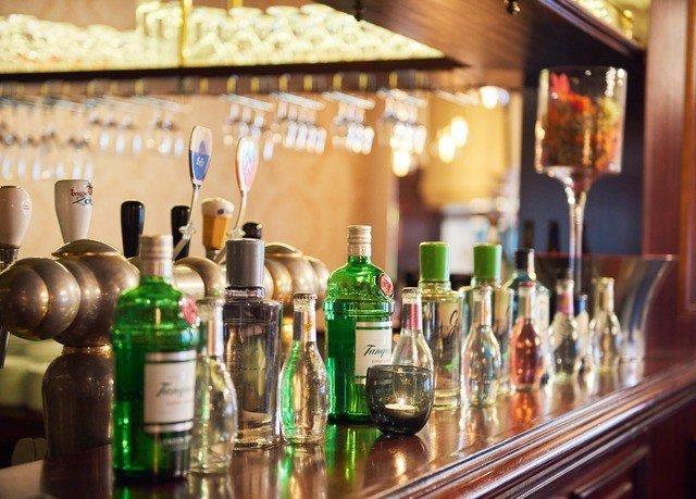 bottle distilled beverage Drink Bar counter cluttered