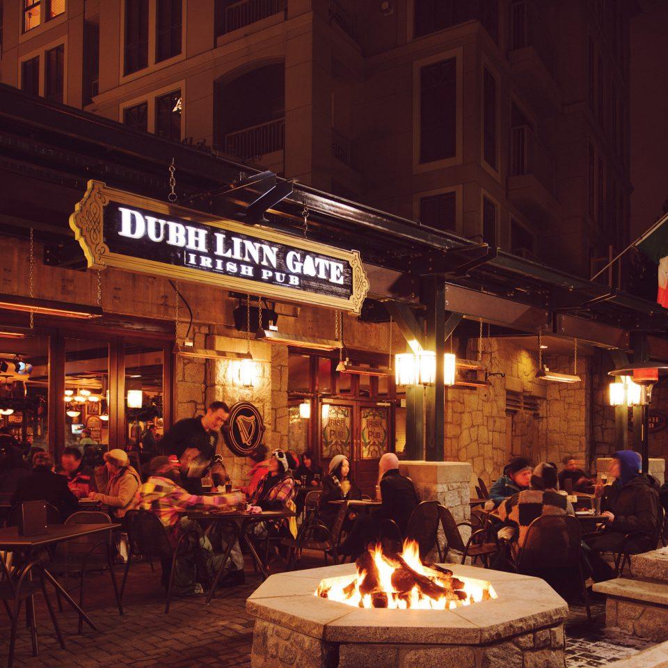 Drink Eat Exterior Firepit Nightlife building night restaurant tavern scene Bar lighting evening