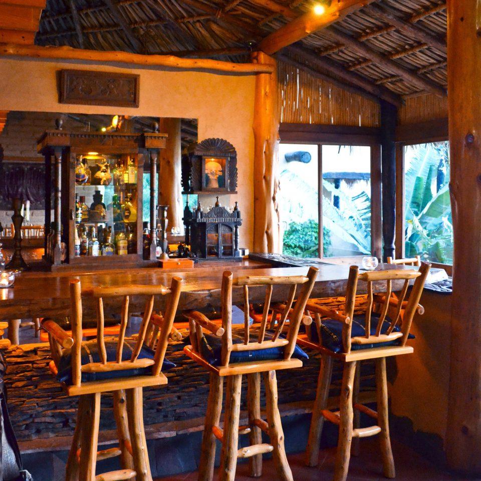 Bar Drink Eat chair restaurant Resort home tavern cottage dining table