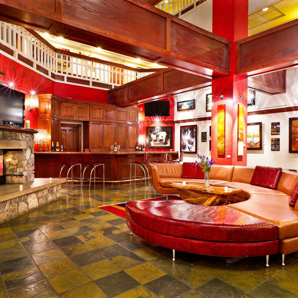 Bar Drink Entertainment Fireplace Lodge Lounge building property living room red Lobby recreation room home house mansion