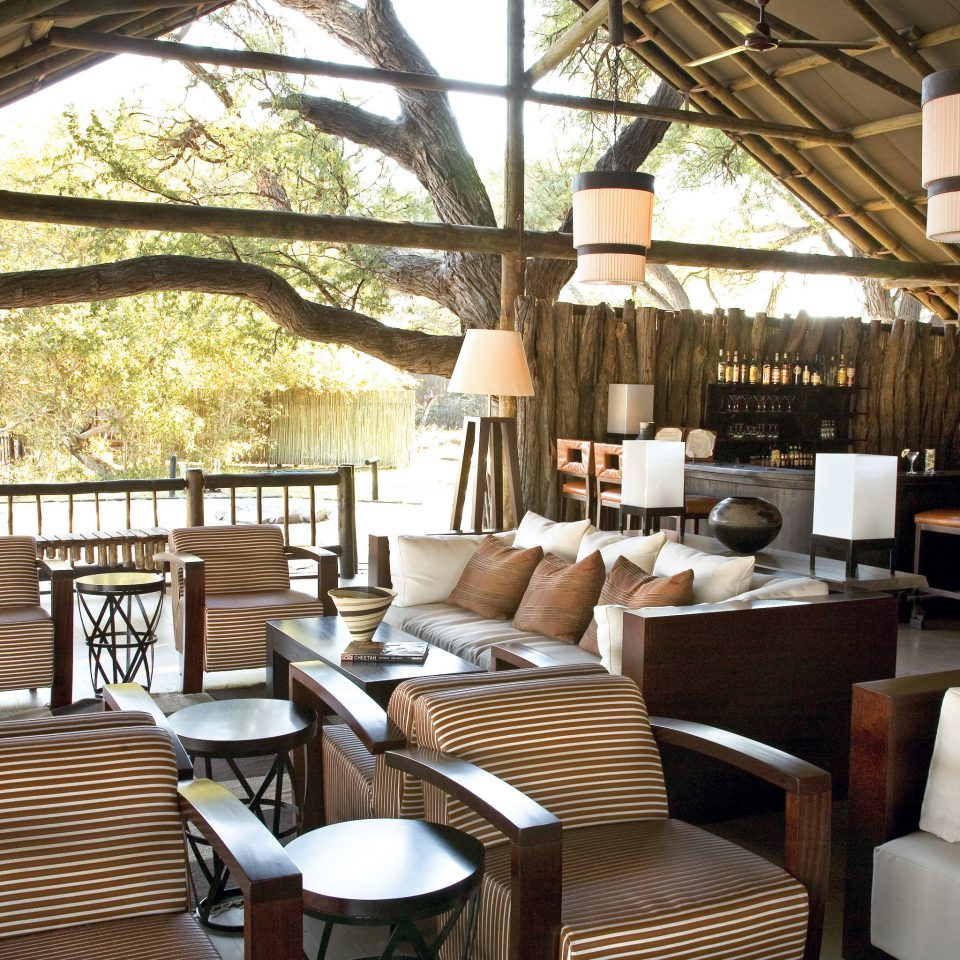 Bar Drink Lodge Lounge chair property restaurant Resort cottage living room home Villa set
