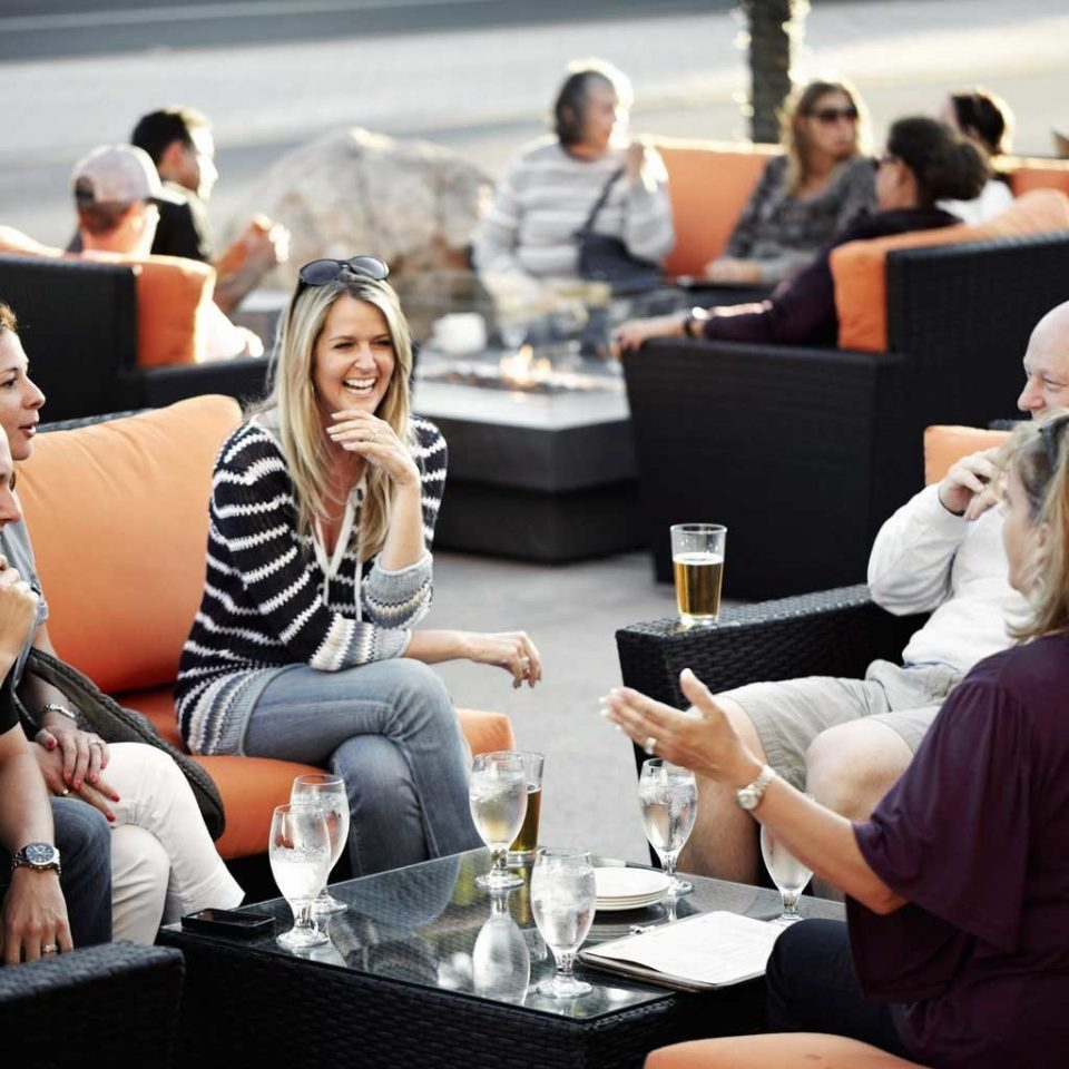 Bar Drink Lodge Lounge sitting conversation audience group academic conference lunch sofa conference room