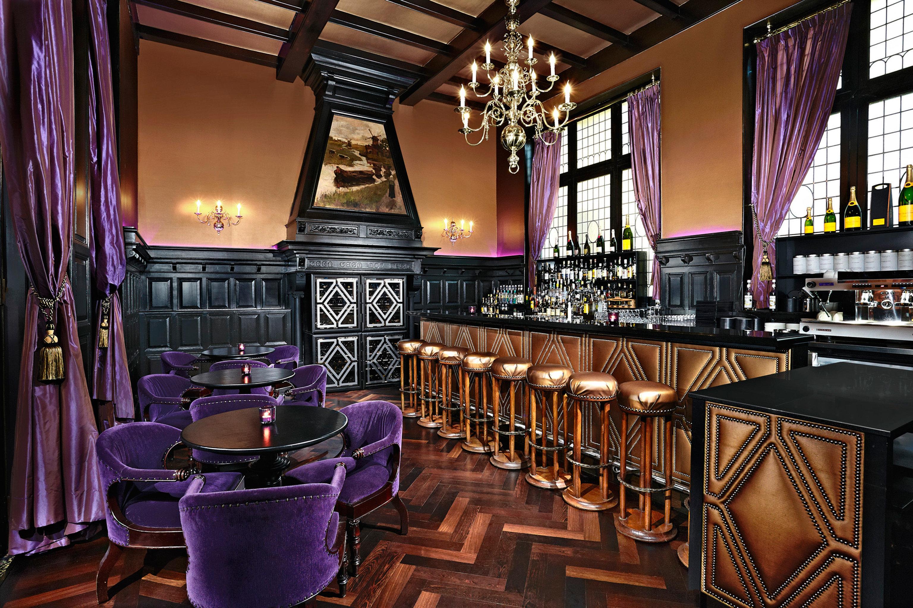Bar Drink Nightlife Resort chair restaurant recreation room purple nightclub