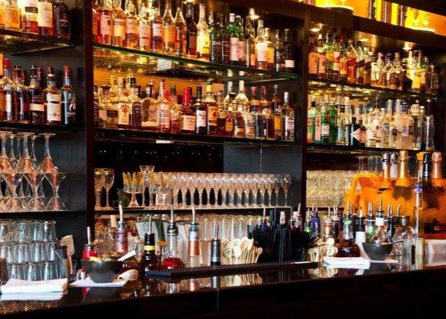 bottle distilled beverage Bar liquor store alcoholic beverage Drink shelf scene alcohol liqueur whisky tavern pub store Shop