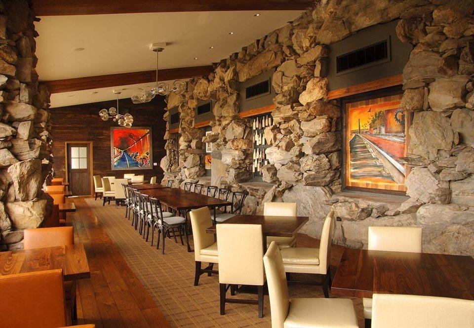 sofa chair Fireplace restaurant stone Bar living room cuisine
