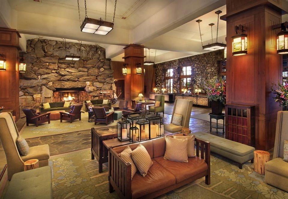 Fireplace Lobby Lounge Resort sofa property restaurant home living room café Bar