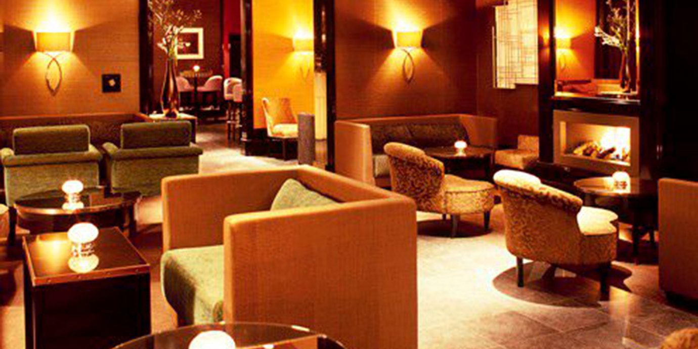 Fireplace Lounge Lobby Suite living room restaurant lighting Bar light lit night lamp