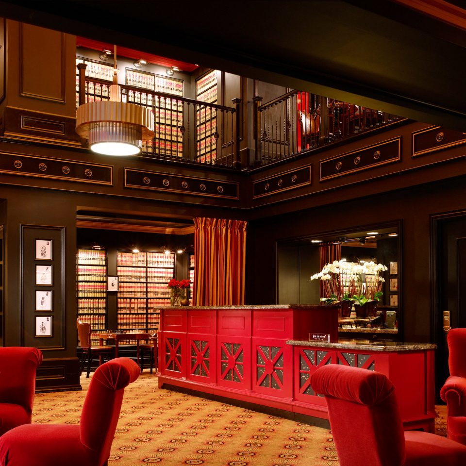Hip Historic Lobby Lounge Modern sofa red chair Bar restaurant function hall movie theater