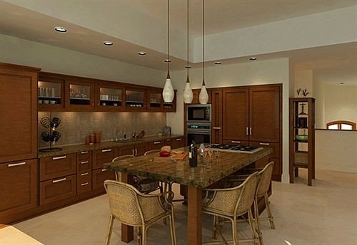 Kitchen property cabinetry hardwood home cottage basement wood flooring countertop appliance stainless Island steel Bar