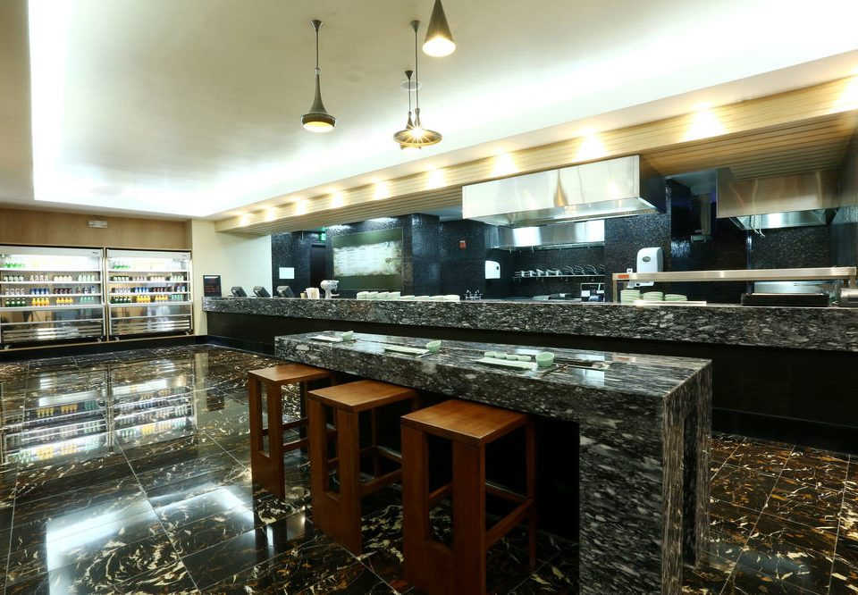 Kitchen property counter countertop restaurant Bar stainless home steel stove Island appliance