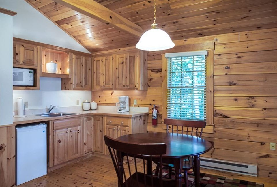 Kitchen property wooden cottage home hardwood farmhouse lighting cabinetry wood flooring Bar Island