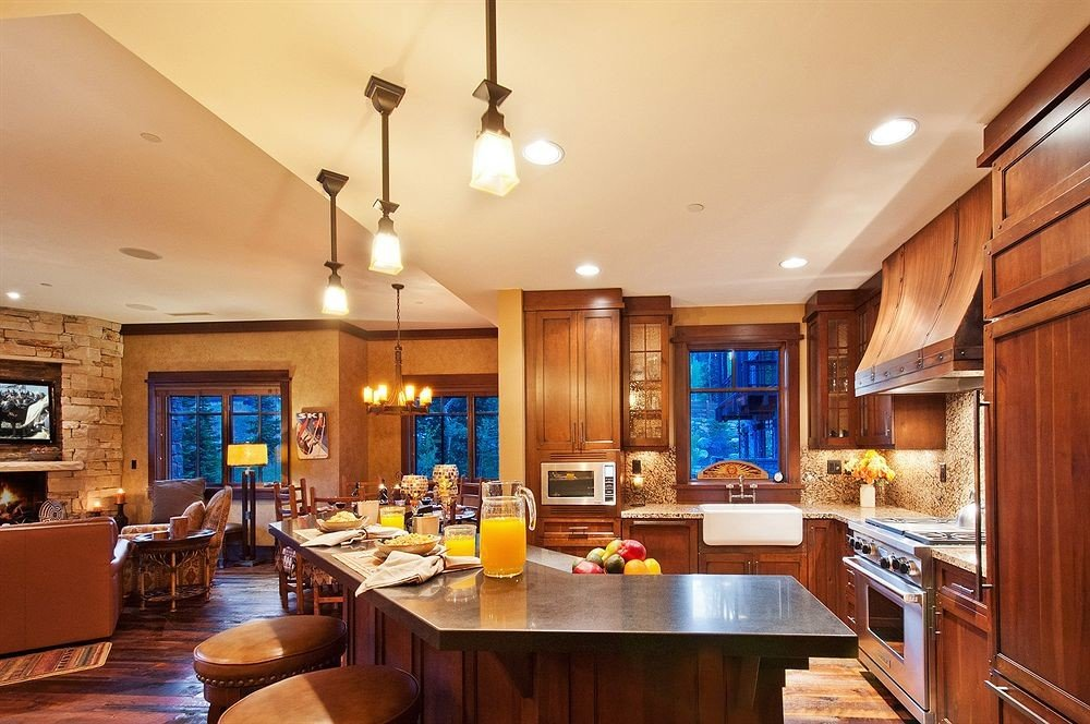 Kitchen property home counter Island hardwood living room cottage Suite cabinetry Bar Modern