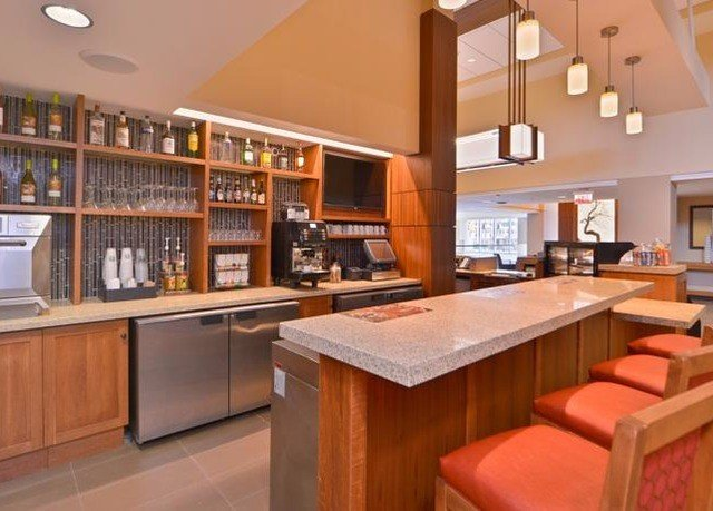 Kitchen property home cabinetry hardwood countertop condominium food cottage Island steel Modern stainless appliance Bar