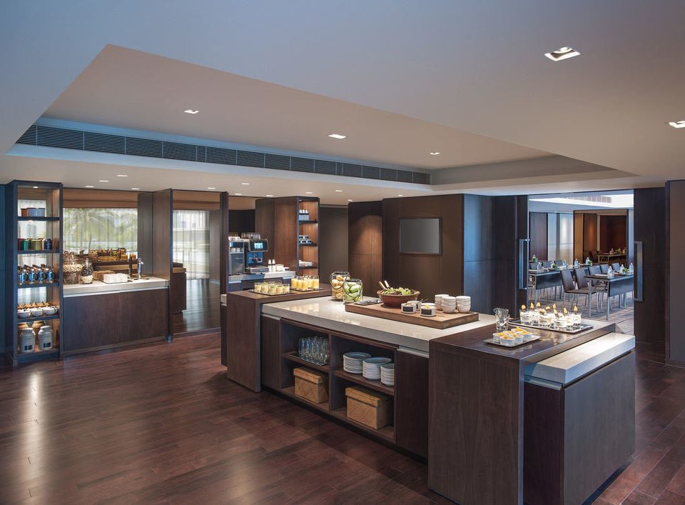 property counter home hardwood Island cabinetry Kitchen condominium living room Bar Modern