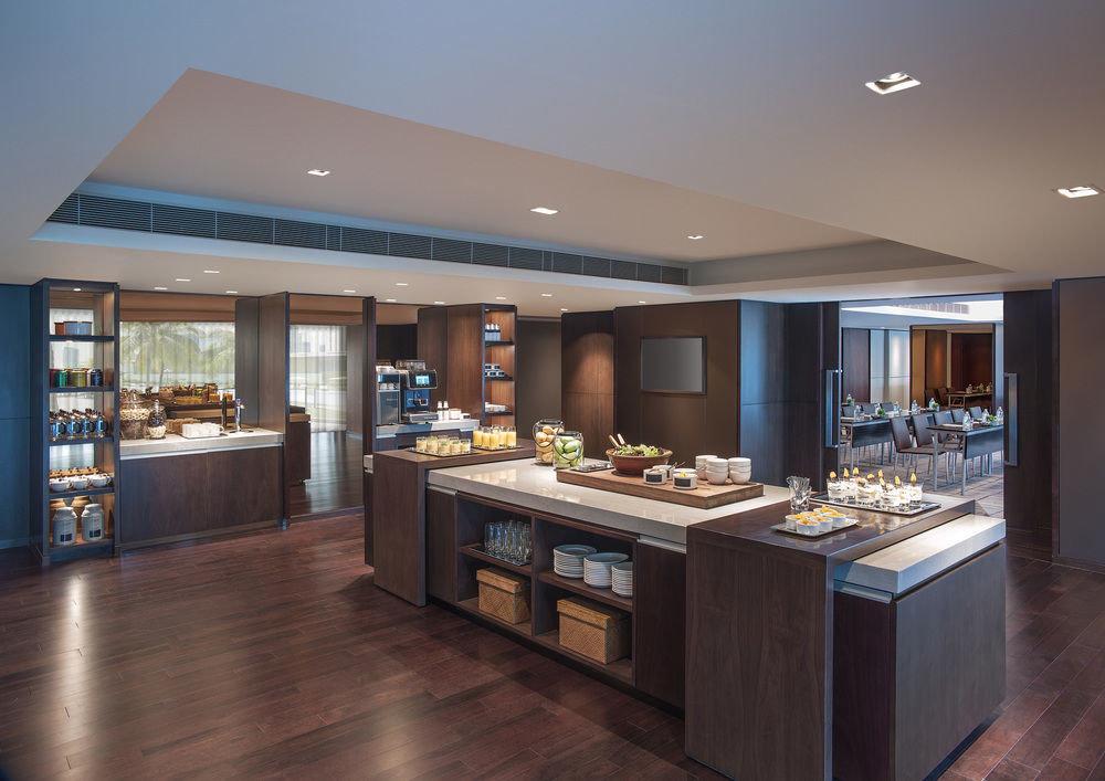 property counter home hardwood Island cabinetry Kitchen condominium living room Bar Modern