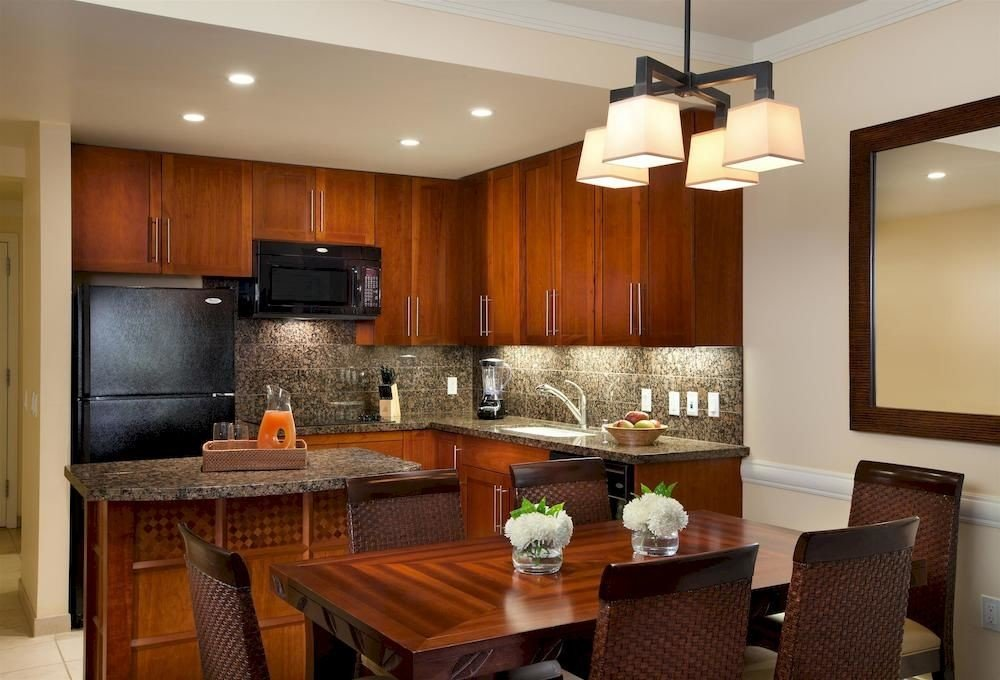 Kitchen property cabinetry home hardwood cuisine classique lighting Suite cottage countertop living room Modern appliance Bar Island