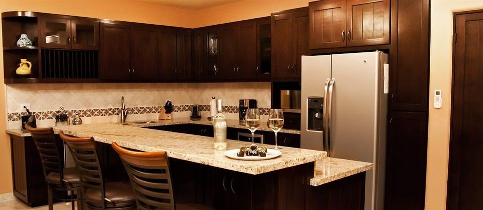 Kitchen property cabinetry home Suite countertop counter cottage stainless appliance steel Island Bar
