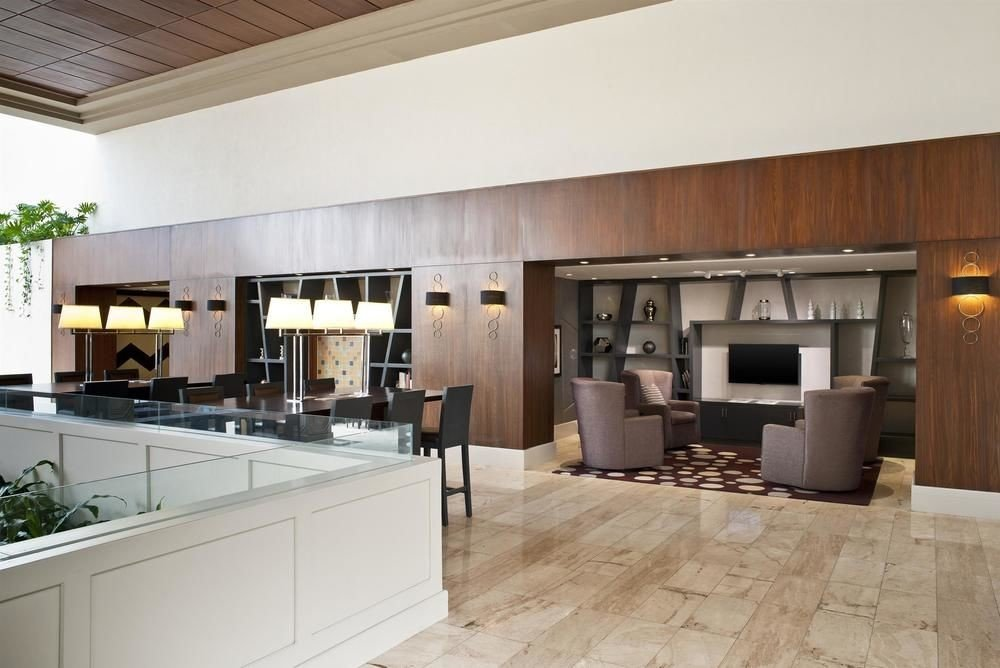 Kitchen property cabinetry counter home living room hardwood cuisine classique flooring condominium appliance countertop loft wood flooring Villa Island Bar