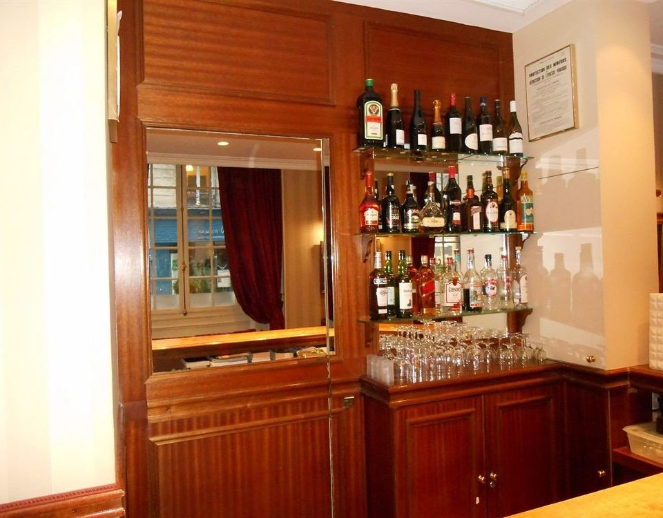 cabinet property Kitchen cabinetry wooden home counter Bar appliance