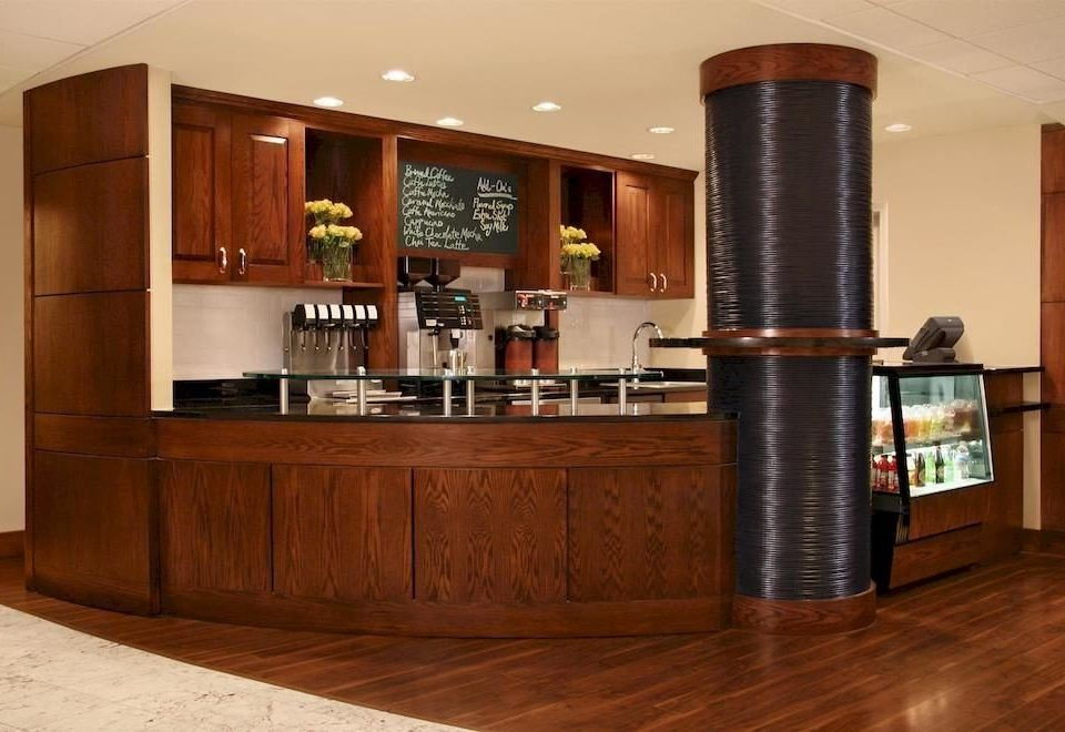 Kitchen property cabinetry hardwood home wood flooring living room flooring appliance stainless Bar steel