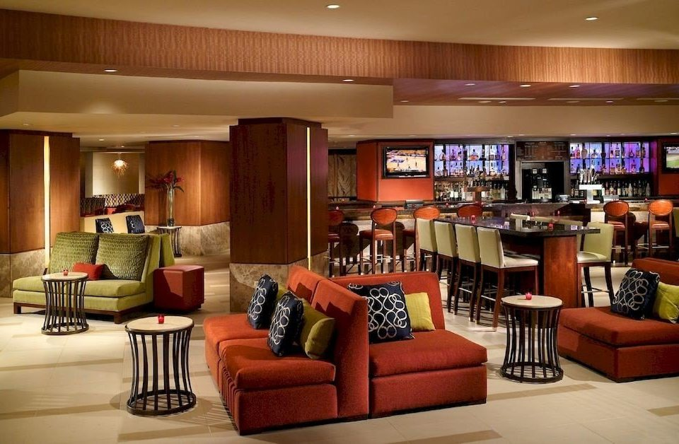sofa property Lobby recreation room living room condominium Bar leather