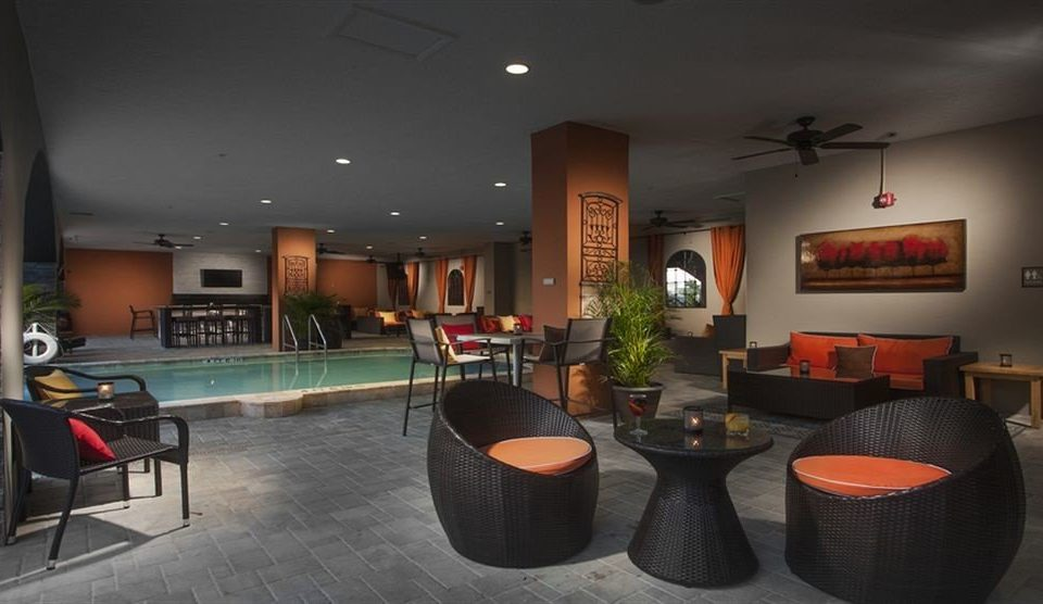 Lounge Pool Wellness property Lobby recreation room living room Bar restaurant orange