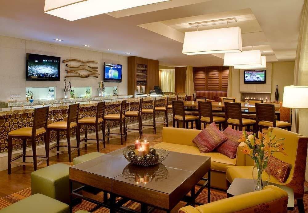 sofa property restaurant Lobby function hall condominium Resort conference hall recreation room café convention center Bar Modern