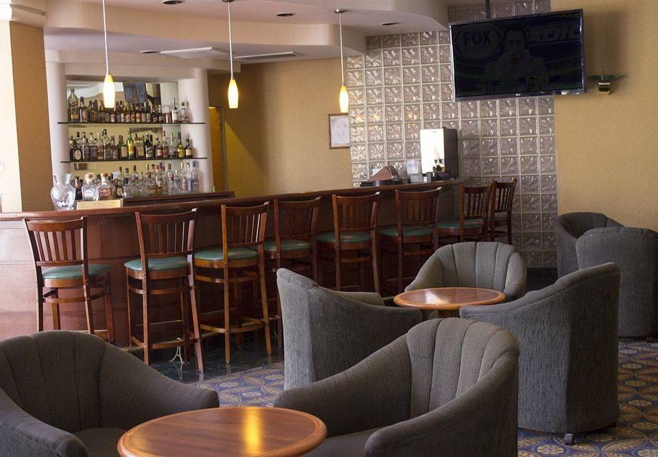 chair property sofa living room seat Lobby home Suite Bar restaurant condominium