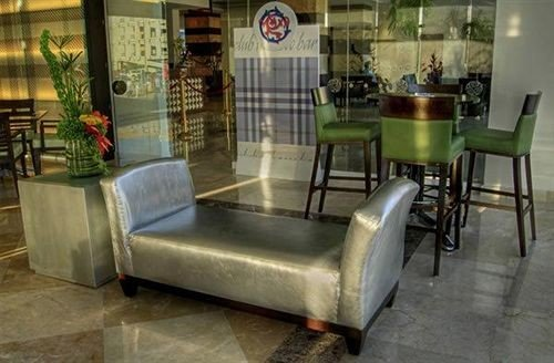chair property Lobby restaurant Bar living room Villa cottage leather dining table