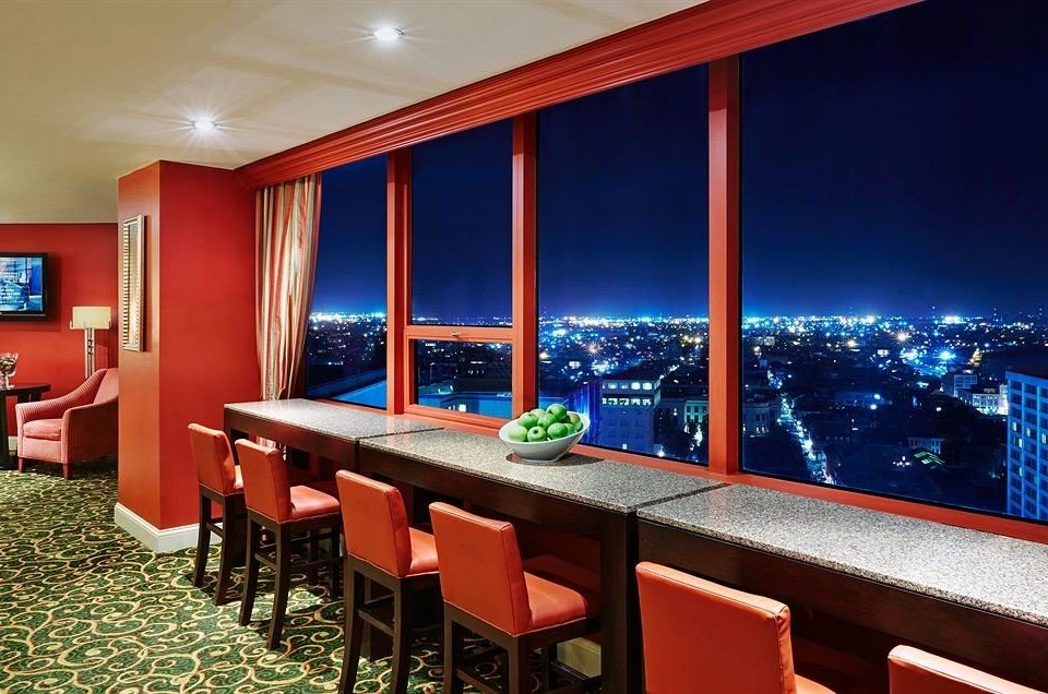 chair property red recreation room Suite Resort restaurant Bar colored colorful lined