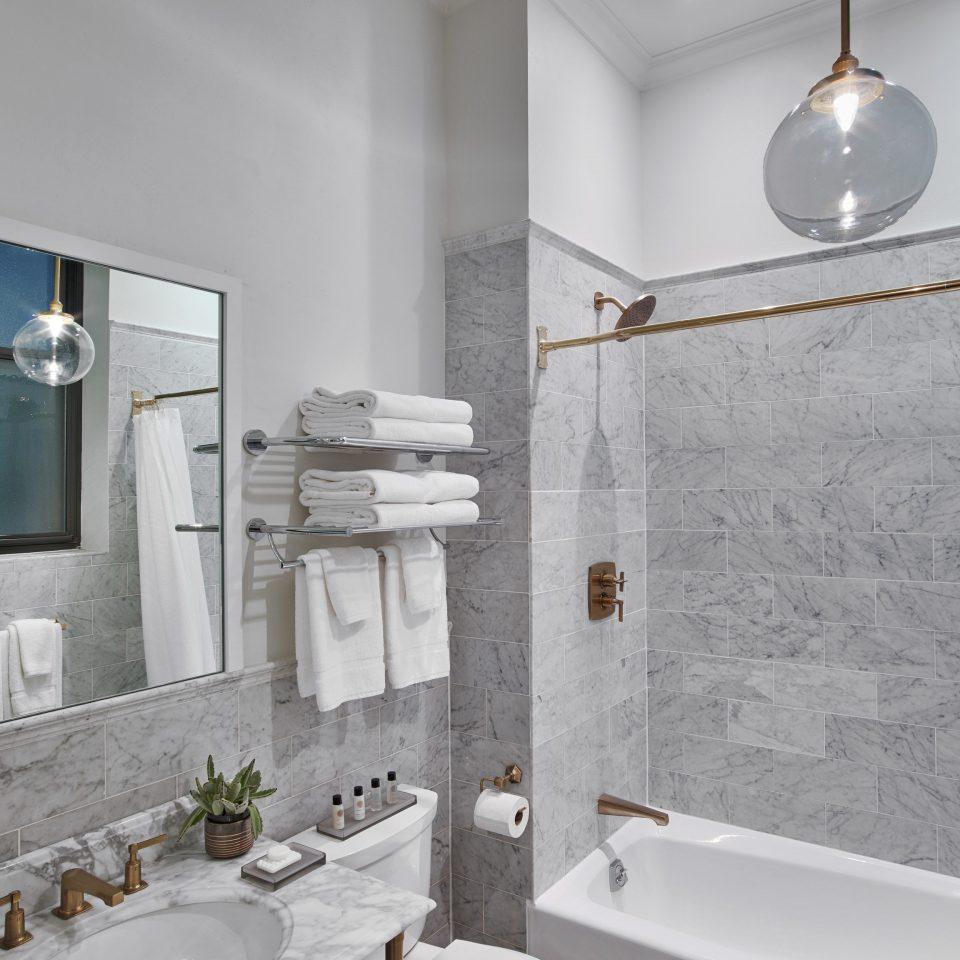 bathroom sink mirror tap home bathroom accessory plumbing fixture tile ceramic bidet product design daylighting angle tub bathroom sink interior designer flooring toilet bathtub Bath tiled