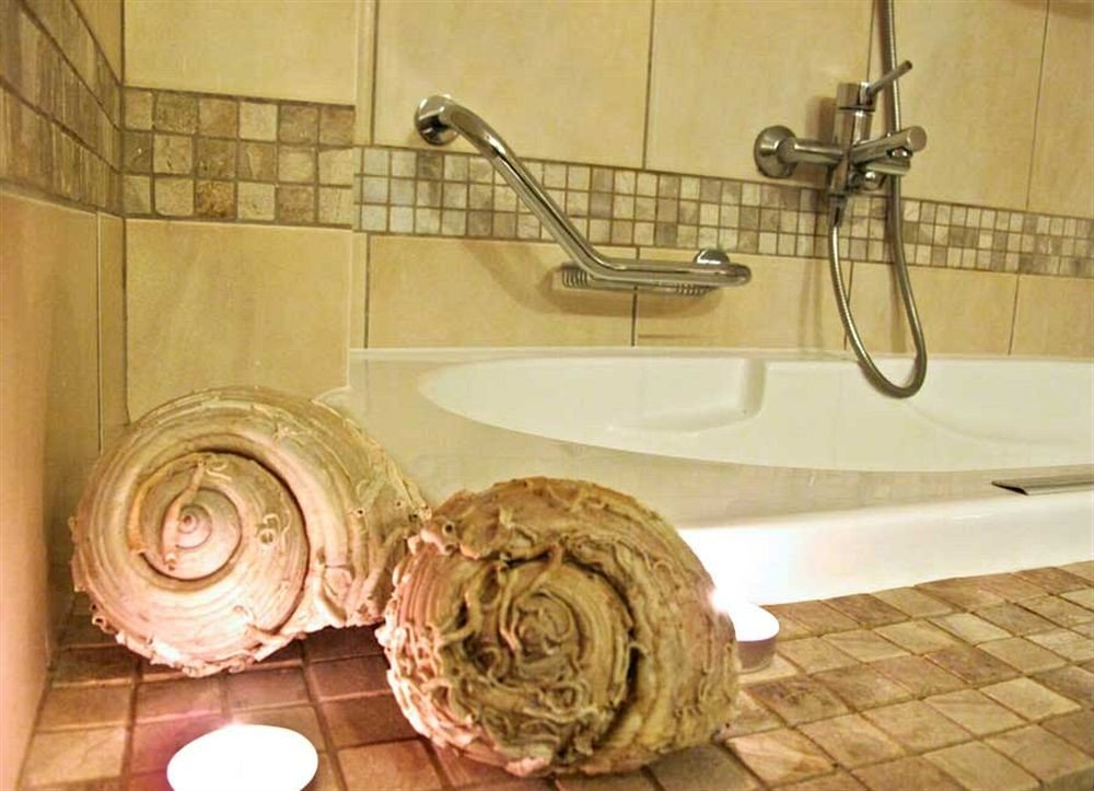 bathroom man made object toilet art lighting carving dirty tiled tile Bath