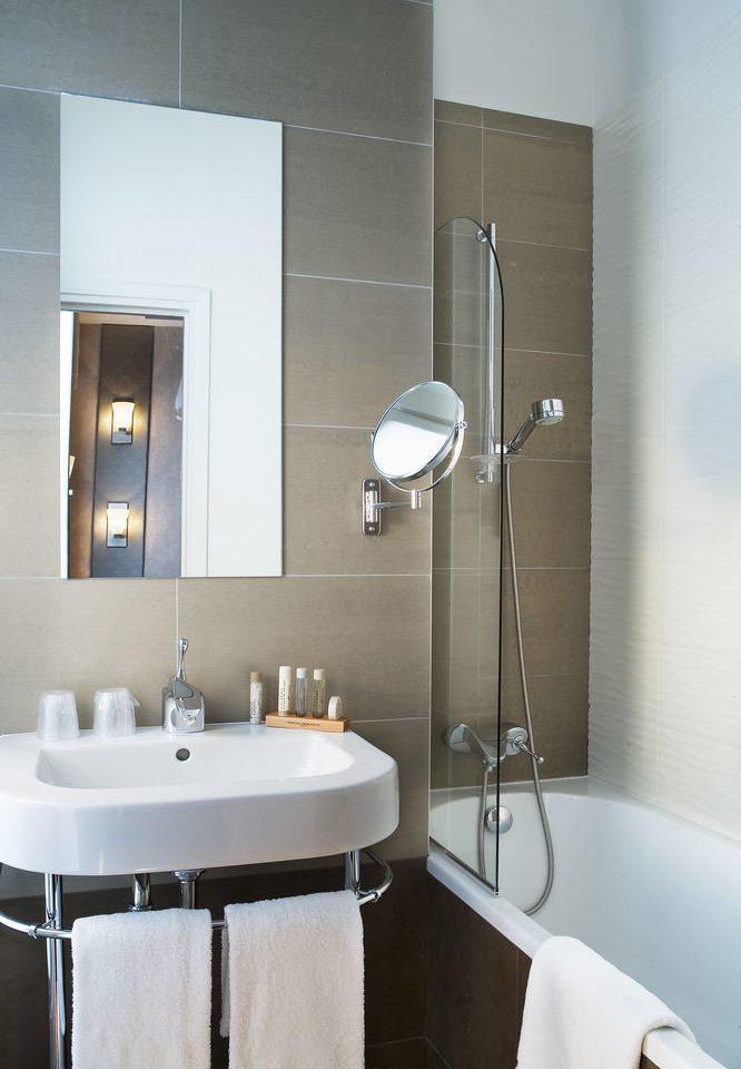 bathroom sink mirror plumbing fixture bidet lighting bathroom cabinet tub Bath bathtub tile tiled