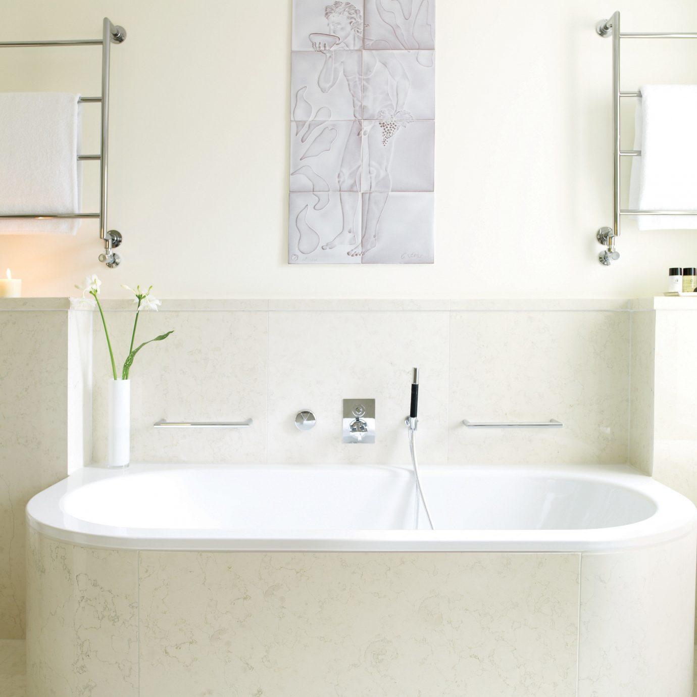 bathroom white vessel bathtub plumbing fixture bidet toilet sink bathroom cabinet tub flooring Bath tile water basin tiled