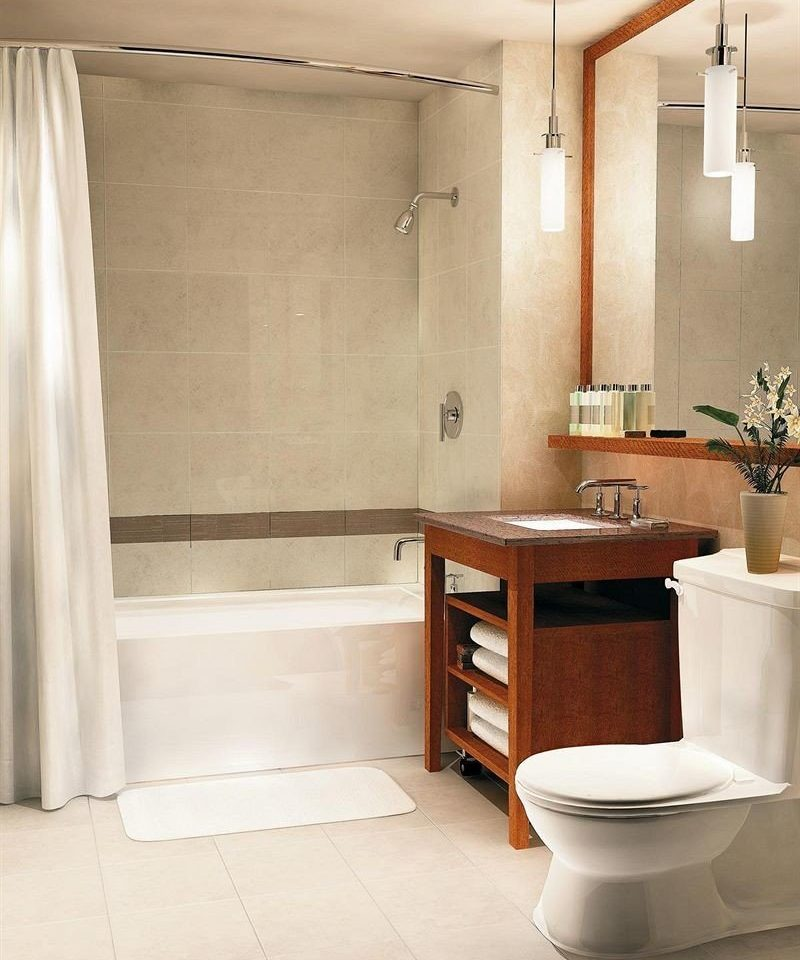 bathroom cabinetry plumbing fixture tub flooring bathtub home sink tile bathroom cabinet Bath tiled
