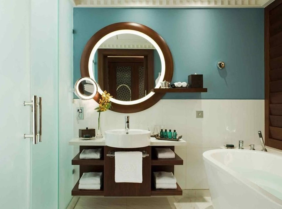 bathroom property mirror sink home plumbing fixture bathroom cabinet flooring tub bathtub Bath