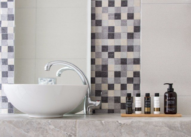 bathroom tile tiled sink flooring plumbing fixture ceramic bathroom cabinet toilet bathtub tub Bath