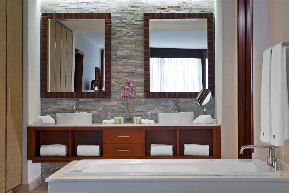 bathroom property cabinetry home sink bathroom cabinet cottage plumbing fixture tub Bath bathtub