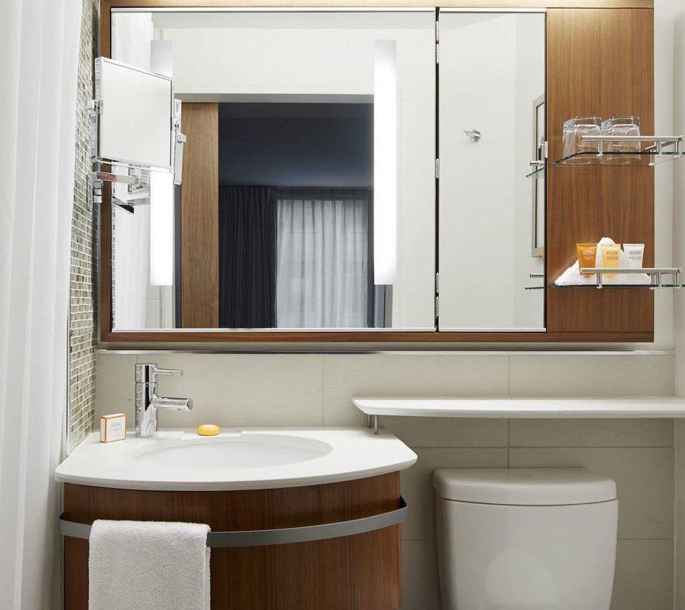 bathroom mirror sink cabinetry bathroom cabinet home plumbing fixture tub bathtub Bath