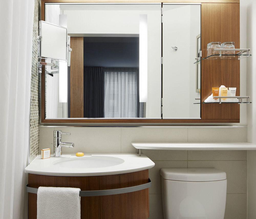 bathroom mirror sink cabinetry bathroom cabinet home plumbing fixture tub bathtub Bath
