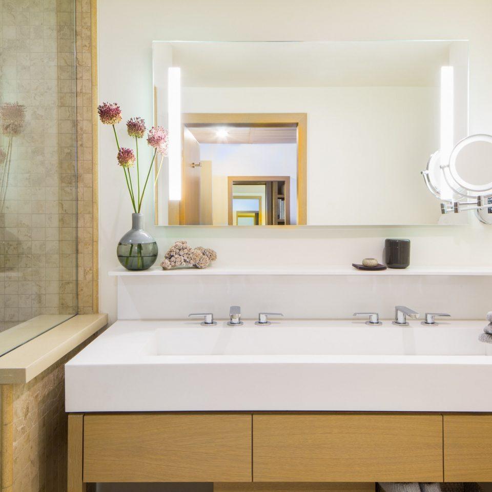 bathroom sink property bathtub home plumbing fixture flooring bathroom cabinet tub Bath tile tiled