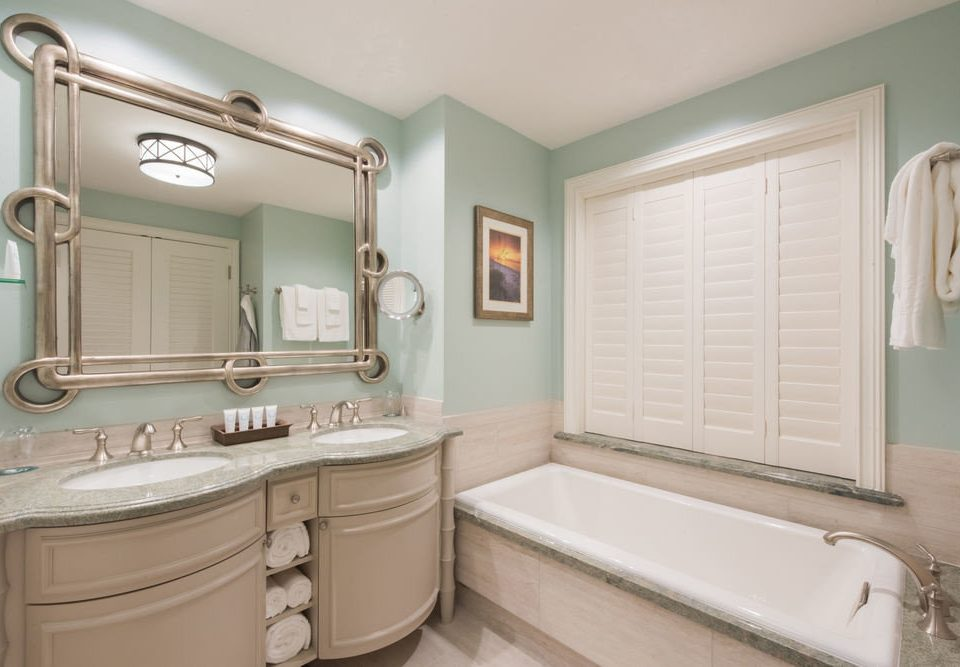 bathroom mirror sink property home toilet vessel cabinetry bathroom cabinet plumbing fixture tub bathtub Bath