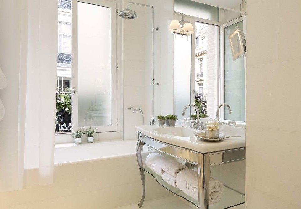 bathroom property sink home cabinetry bathroom cabinet cottage bathtub tub Bath
