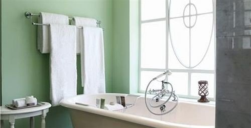 bathroom sink plumbing fixture bidet toilet bathtub bathroom cabinet tub Bath rack tiled