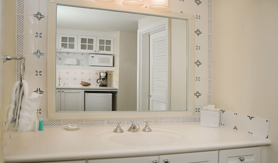 bathroom white sink mirror home bathroom cabinet plumbing fixture living room cabinetry bathtub Bath