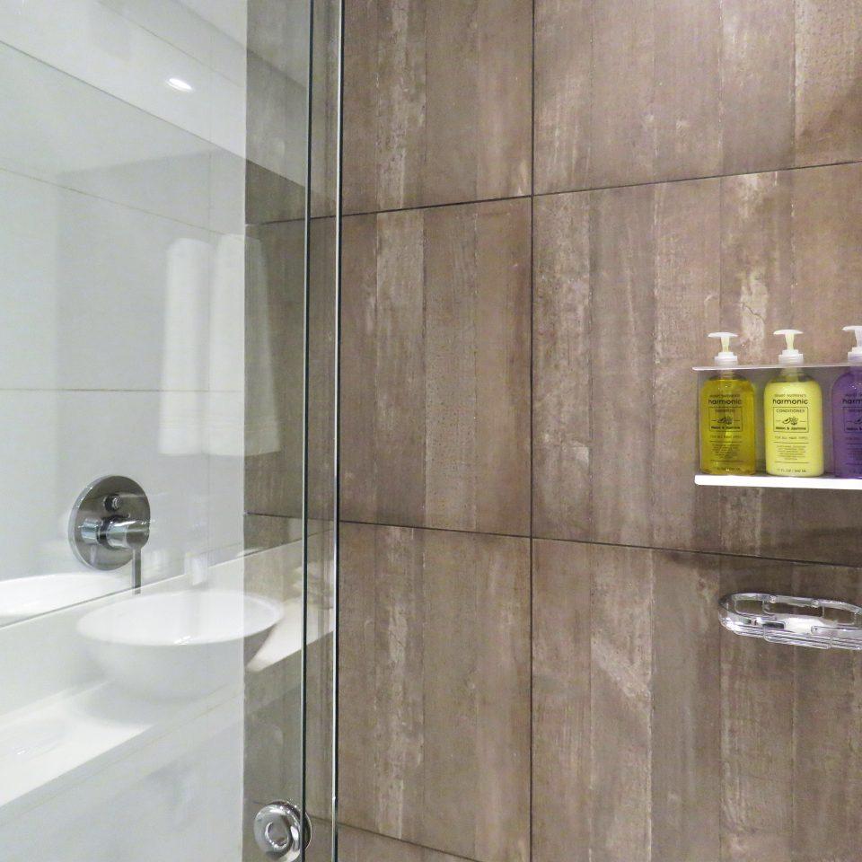 Bath bathroom property plumbing fixture toilet flooring tile bathroom cabinet public water basin tiled