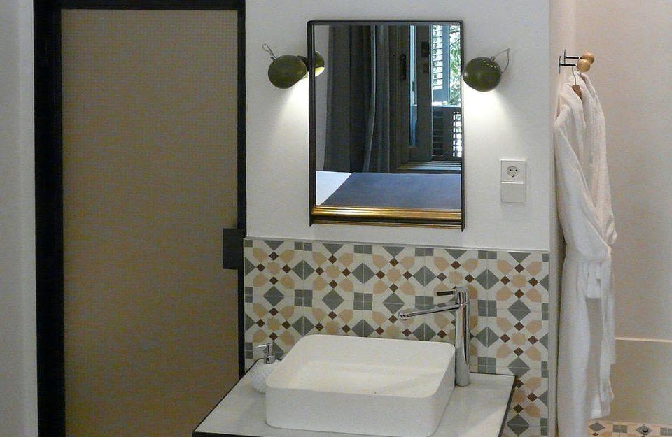 bathroom mirror sink plumbing fixture bathroom cabinet Bath tub tiled