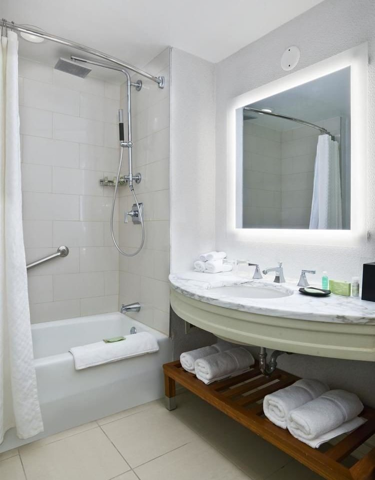 bathroom sink mirror property plumbing fixture white bathtub bidet toilet towel tub tile Bath tiled