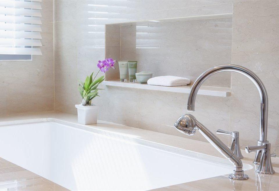 bathroom bathtub sink plumbing fixture tub bidet flooring tap countertop tile swimming pool Bath